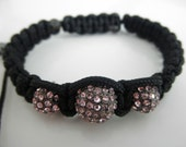 Macrame bracelet on black with pink pave crystal ball