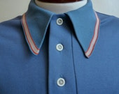vintage 70's periwinkle polyester polo shirt with pocket with red and grey collar trim