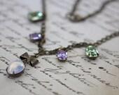 Vintage estate necklace Chrysolite Alexandrite white opal antique brass bow retro romance light green purple