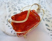Rare 'Divine Fire' Andara volcanic glass wire wrapped pendant