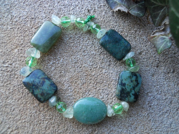 Green beaded stretch bracelet with jade, faceted crystals, jasper and prehnite chips