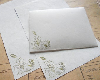 Parchment paper stationery set. Writing paper hand stamped with a seashell beach theme, set of 30.