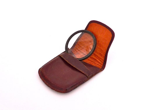 Vintage magnifying glass in leather case