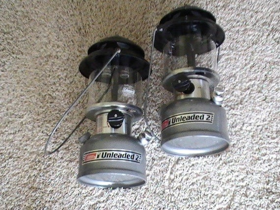 two coleman unleaded 2 lanterns