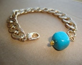 Gold chain and blue chunky bead bracelet