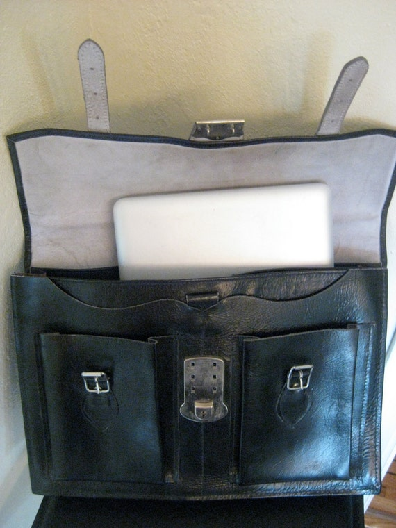 Vintage leather briefcase  school bag made entirely of  thick genuine leather.