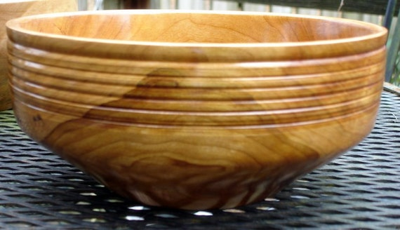 Hand turned cherry bowl with beautiful figure and grain.
