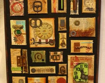 Collage on wood base