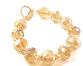 Paris - Faceted Champagne Colored Rondelles and Disco Ball Shaped Beads.