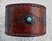 Leather Southwestern themed cuff / bracelet / wristband inlaid with a turquoise bead.