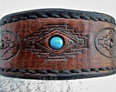 Brown or black reversible cuff bracelet with Southwestern geometric design and bead inlay.