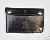 Men's black leather wallet with embossed eagle design and snap closures.