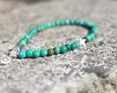 Turquoise and sterling silver star and heart charm bracelet