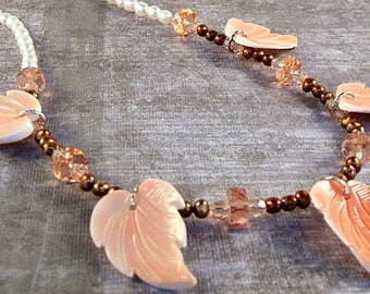 White pearl necklace with peach shell leaves and bronze pearls