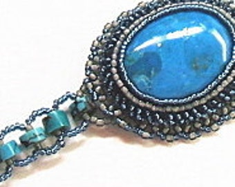 Turquoise bracelet with bead embroidered cabochon