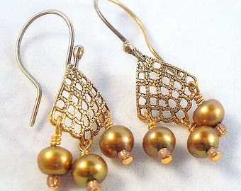 Gold pearl chandelier earrings with brass filigrees