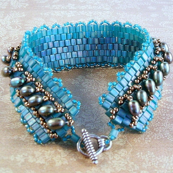 Teal bracelet band woven with bronze pearls and cube beads