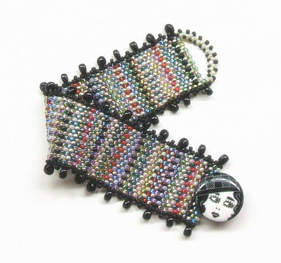 Multicolor bracelet band, woven in black, red, blue, gold, green, pink