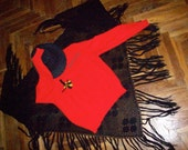 bright red women's cardigan with a fancy patch