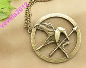 Necklace--------The Hunger Games pendant ,Inspired Mockingjay Necklace------bird with arrow