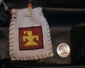 Medicine bag with a square thunderbird motif beaded leather