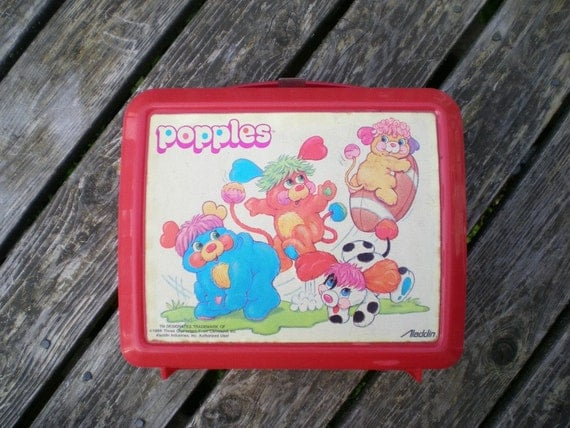 vintage 80s lunchbox Popples cartoon playing football. saturday morning cartoons nostalgia.