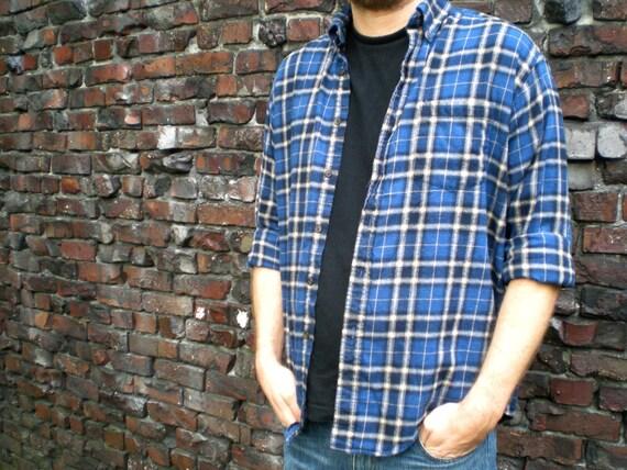 blue plaid flannel shirt. long sleeve, button up. size medium.