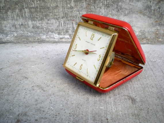 vintage travel clock in red case by Phinney-Walker