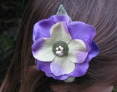 small purple flower reserved for Leann