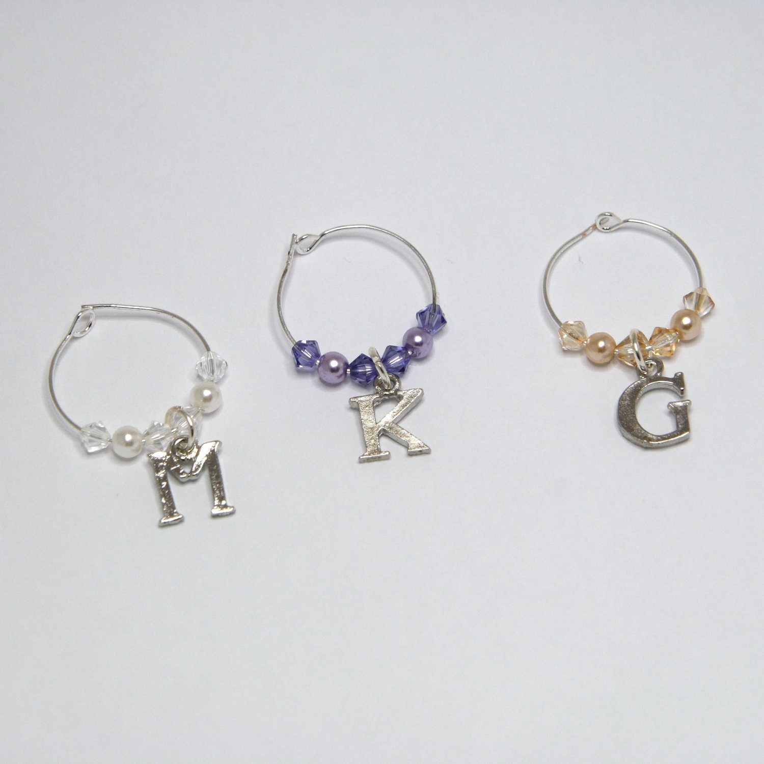 custom wine glass charms with letter by willowbrookartistry