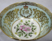 Paragon HRH Queen ELIZABETH Shimmering Gold Simply Tea cup and saucer. England.