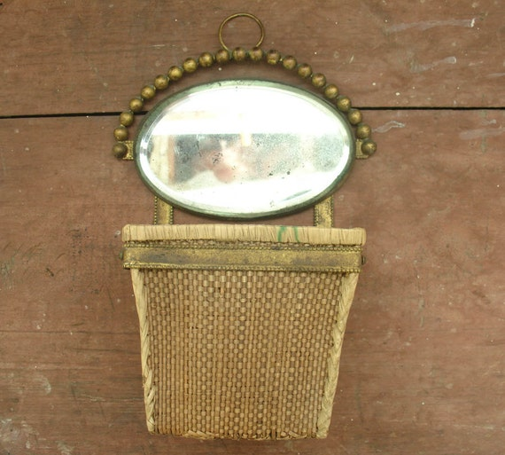 antique victorian hanging wall basket with beveled oval mirror
