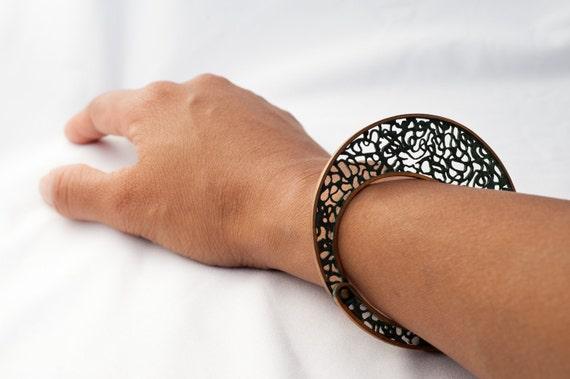 Handmade green hued bronze filigree bracelet. Unique vertical flat design