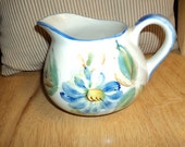 Lovely hand-painted pitcher from Portugal.
