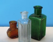 A set of 3 Vintage Glass Apothecary Bottles