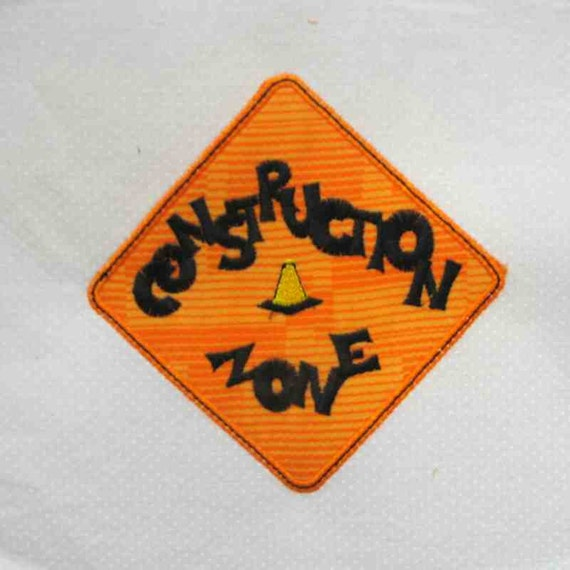 Construction zone sign applique and embroidered by