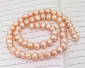 One Full Strands----- Luster Pure Pink Freshwater Pearl----7mm----about 56Pieces----15inch One strand