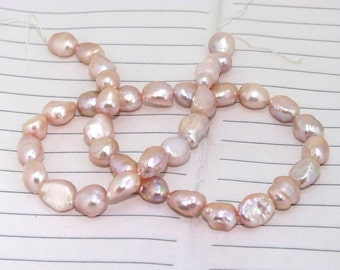 One Full Strand-----Luster Lavender Rice Pure Freshwater Pearl----8mm-10mm----about 38Pieces----15inch strand