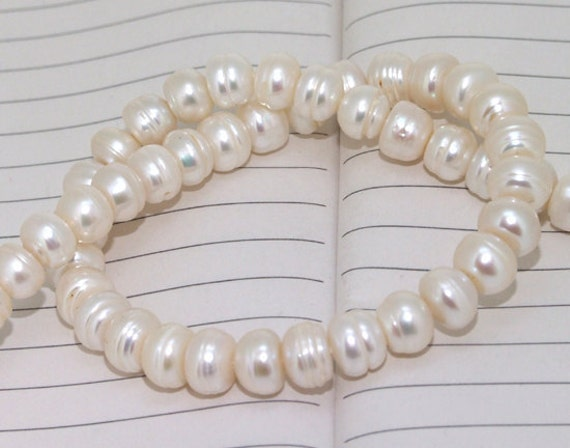 One Full Strand--- White Pure Freshwater Pearl----9mm----about  54 Pieces----15 inch strand