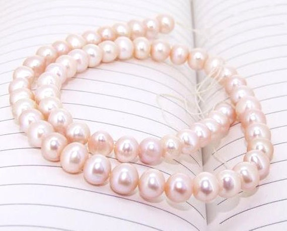 One Full Strand--- Pink  Peach Pure Freshwater Pearl----7mm-8mm----about more 36 Pieces----9.5 inch strand