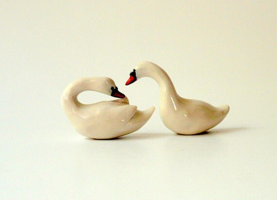 A Pair of Snowy White Porcelain Swans