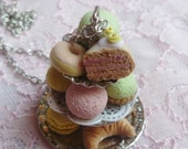 Sweet cake stand necklace with macarons, donuts, cupcakes and pastries