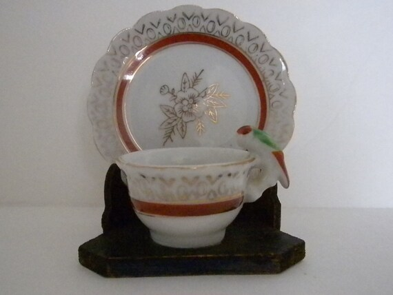 Reserved listing, Vintage, Tea Cup with a Bird Perched on its Handle. All on wooden Stand, 1950