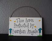 this home protected by guardian angels .. hanging sign