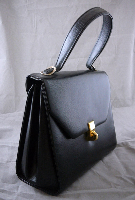 Saks Fifth Avenue black leather handbag with brass fittings and matching coin purse