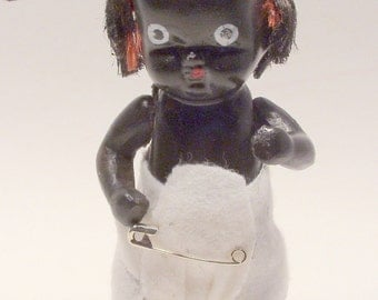 Black Bisque China Doll with Moveable Arms and Legs