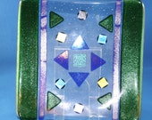 Geometric fused glass plate with iridescent green border and dichroic accents 50% off Clearance Sale