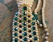 necklace, vintage pearl tie, brilliant teal green crystal embellishments, elegant and fun, crystal hook closure.