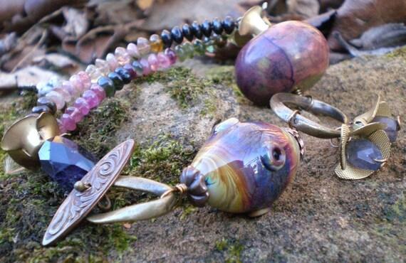 Passionately- plum multi strand bracelet. large purple turquoise. lampwork bead. vintage brass flowers. Jettabugjewelry
