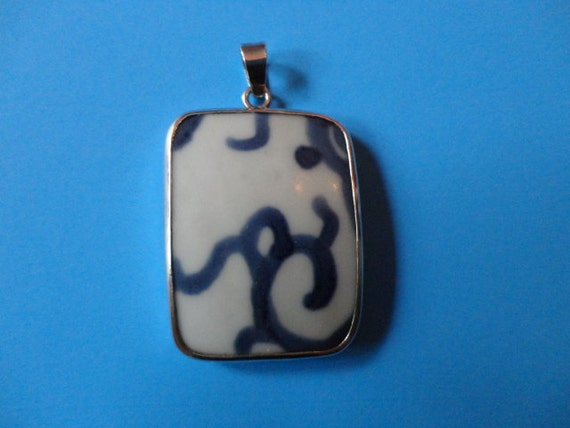 Antique pottery chard from the Ming Dynasty edged in a sterling silver border